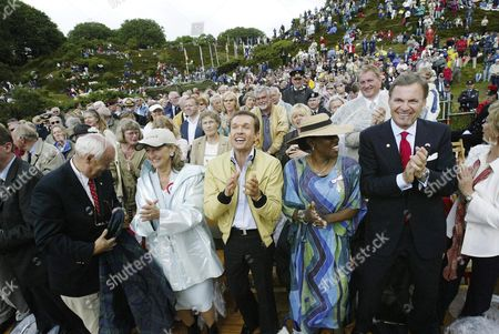 Stock Picture of From Left: Harald Nielsen President of the Rebild Society and Former Danish Soccer Star His Wife Mie Nielsen Ole Henriksen the American Principal Speaker and Danish Born Hollywood Make-up Artist the Danish Principal Speaker Etta Cameron Jazz Singer and Former American Citizen Us Ambassador Stuart Bernstein and His Wife Wilma Bernstein Enjoy Themselves During the Traditional Danish Celebration of the American National Day in Rebild National Park in Northern Jutland Sunday 04 July 2004 the Fourth of July Event at Rebild is Regarded the Biggest Outside Usa Denmark Rebild Bakker