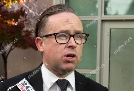 Qantas Airways chief executive Alan Joyce speaks to media, at Parliament House in Canberra, Australia. A man who squashed a lemon meringue pie into Qantas Airways chief executive Joyce's face during a public address in Australia says he was protesting Joyce's advocacy for same-sex marriage. Joyce was giving a speech to 500 people in a Perth hotel on Tuesday when Tony Overheu approached from behind, pressed the pie in his face then fled