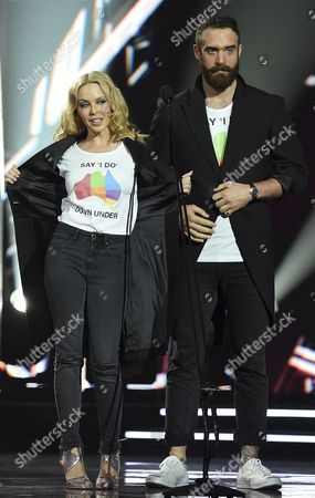 A Picture Made Available on 24 November 2016 Shows Australian Singer Kylie Minogue (l) with Her Fiance British Actor Joshua Sasse Introducing Troye Sivan's Performance During the 30th Aria Awards at the Star in Sydney New South Wales Australia 23 November 2016 the Couple Showed Off Marriage Equality Campaign Shirts Australia Sydney