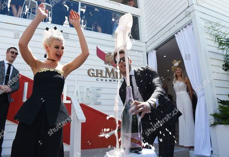 Kate Peck (l) and Didier Cohen (r) Pop a Champagne Cork with a Sabre in the Birdcage During the Aami Victoria Derby Day Horse Racing at Flemington Racecourse in Melbourne Victoria Australia 29 October 2016 Australia Melbourne