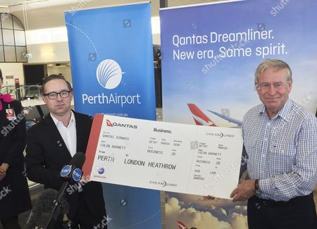 A Picture Made Available 12 December 2016 Shows Western Australia Premier Colin Barnett (r) and Qantas Ceo Alan Joyce (l) Hold a Mock Boarding Pass During a Press Event at Perth Airport in Perth Western Australia Australia 11 December 2016 According to Media Reports on 12 December 2016 Qantas Airways Confirmed It Will Operate Non-stop Flights on Its New 787-9 Dreamliner Aircraft Between Perth and London Beginning March 2018 Australia Perth