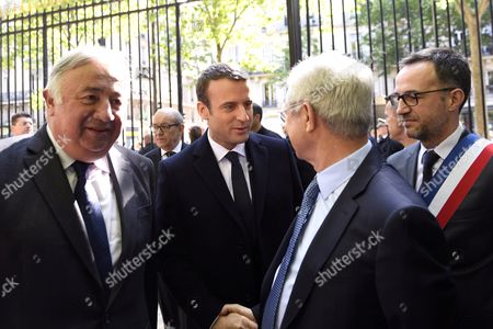 French president-elect Emmanuel Macron (C) shakes hands with French National Assembly president Claude Bartolone (R-2) as Senate president Gerard Larcher (L) looks on, during a ceremony to mark the anniversary of the abolition of slavery, at the Jardins du Luxembourg in Paris, France, 10 May 2017. at the Jardins du Luxembourg