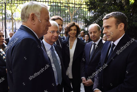 French president-elect Emmanuel Macron (R) speaks with French Foreign Minister Jean-Marc Ayrault (L) as French National Assembly president Claude Bartolone (L-2), French Culture Minister Audrey Azoulay (C) and French Justice Minister Jean-Jacques Urvoas (R-2) look on, during a ceremony to mark the anniversary of the abolition of slavery, at the Jardins du Luxembourg in Paris, France, 10 May 2017. at the Jardins du Luxembourg
