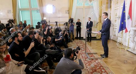 Austrian Chancellor Christian Kern, right, speaks to the media at the federal chancellery in Vienna, Austria, after Vice Chancellor Reinhold Mitterlehner fromt the conservative People's party OEVP, announced his resignation