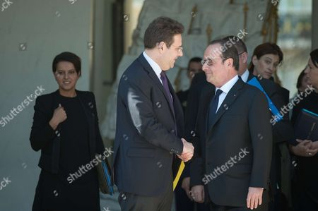 French president, Francois Hollande shake hands with Matthias Fekl