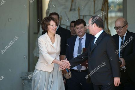 French president, Francois Hollande shake hands with Marisol Touraine