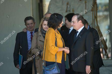 French president, Francois Hollande shake hands with Myriam El Khomri