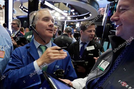 Stock Photo of Timothy Nick, Patrick Casey Traders Timothy Nick, left, and Patrick Casey, right, work on the floor of the New York Stock Exchange, . U.S. stock indexes are mostly lower Wednesday morning following weak first-quarter reports from consumer-focused companies including Priceline and Disney