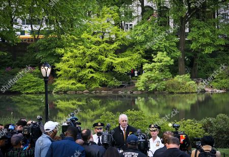 NYPD Chief of Detectives Robert Boyce, center, stands between police commanders during a press conference in front of the area where a body was pulled from a pond in Central Park, in New York. The discovery came a day after the body of another man was recovered in the Jacqueline Kennedy Onassis Reservoir near Central Park West and 90th Street