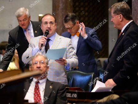 Senator Paul Bailey, R-Sparta, center, speaks on the floor of the Senate, in Nashville, Tenn