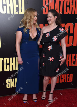 Amy Schumer and Kim Caramele
