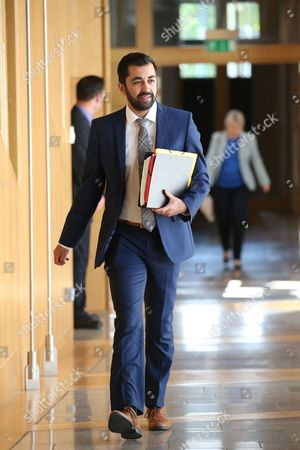 Humza Yousaf, Minister for Transport and the Islands makes his way to the Debating Chamber