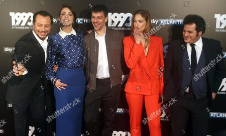 Stock Image of (L-R) Stefano Accorsi; Miriam Leone; Domenico Diele; Teal Falco e Antonio Geradi pose during a photocall for '1993', Italian Television Series, that will be broadcasted on Sky Atlantic HD in Milan, Itlay, 11 May 2017.