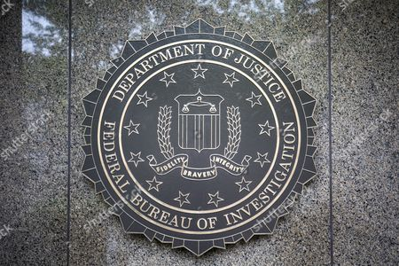 The seal of the Federal Bureau Of Investigation (FBI), the domestic intelligence and security service of the United States, at the facade of the J. Edgar Hoover FBI Building, in Washington, DC, USA, 11 May 2017. U.S. President Donald J. Trump on 09 May 2017 fired FBI director James Comey, regarded a controversial move given that Comey is investigating possible collusion between Russia and the Trump campaign.