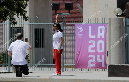 Patrick Baumann, Nawal El Moutawakel International Olympic Committee's Evaluation Commission Chair Patrick Baumann, left, takes pictures of IOC member Nawal El Moutawakel outside the Los Angeles Memorial Coliseum, in Los Angeles. After bidding for the 2024 Olympics, Los Angeles might have to wait. With the competition down to LA and Paris, IOC leaders are considering a proposal to award the next two Olympics, 2024 and 2028, one to each city