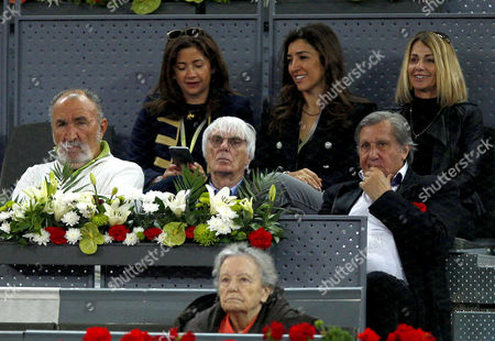 Ilie Nastase sits next to Bernie Eccleston and Ion Tiriac at the Mutua Madrid Open, Madrid, Spain on Thursday, May 11th, 2017