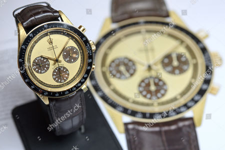 The Rolex in 18k gold, chronograph wristwatch with tropical lemon dial and white numerals inside the subsidiary dials, cosmography Daytona, Paul Newman model, during a preview at the Christie's, in Geneva, Switzerland, 11 May 2017. It is estimated to sell between 500,000-800,000 US dollars. The auction will take place in Geneva, on 15 May.