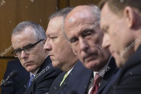 Acting FBI Director Andrew McCabe (L) listens to testimony from National Security Agency Director Admiral Mike Rogers (R), beside CIA Director Mike Pompeo (2-L) and Director of National Intelligence Daniel Coats (2-R), during the Senate Select Committee on Intelligence hearing on 'World Wide Threats', on Capitol Hill in Washington, DC, USA, 11 May 2017. Senate Democrats have strongly criticized US President Donald J. Trump's firing of James Comey as Director of the FBI. Some Senators are calling for the appointment of a special prosecutor to take over the inquiry into Russia's interference in the US presidential election of 2016. Also in this picture (L to R); CIA Director Mike Pompeo, Director of National Intelligence Daniel Coats, National Security Agency Director Admiral Mike Rogers, Defense Intelligence Agency Director Lieutenant General Vincent Stewart and National Geospatial-Intelligence Agency Director Robert Cardillo.
