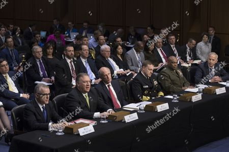 Intelligence leaders appear before the Senate Select Committee on Intelligence hearing on 'World Wide Threats', on Capitol Hill in Washington, DC, USA, 11 May 2017. Senate Democrats have criticized US President Donald J. Trump's firing of James Comey as Director of the FBI. Some Senators are calling for the appointment of a special prosecutor to take over the inquiry into Russia's interference in the US presidential election of 2016. In this picture (L to R); Acting FBI Director Andrew McCabe, CIA Director Mike Pompeo, Director of National Intelligence Daniel Coats, National Security Agency Director Admiral Mike Rogers, Defense Intelligence Agency Director Lieutenant General Vincent Stewart and National Geospatial-Intelligence Agency Director Robert Cardillo.