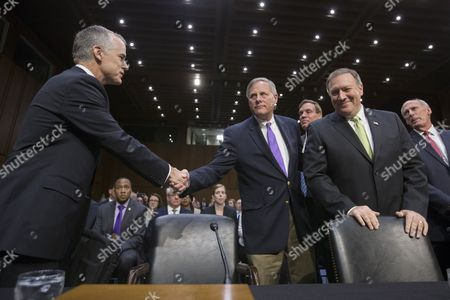 Acting FBI Director Andrew McCabe (L) shakes hands with Chairman of the Senate Select Committee on Intelligence Richard Burr (C); beside ranking member of the Senate Select Committee on Intelligence Mark Warner (3-R), CIA Director Mike Pompeo (2-R) and Director of National Intelligence Daniel Coats (R) at the Senate Select Committee on Intelligence hearing on 'World Wide Threats', on Capitol Hill in Washington, DC, USA, 11 May 2017. Senate Democrats have strongly criticized US President Donald J. Trump's abrupt firing of James Comey as Director of the FBI. Some Senators are calling for the appointment of a special prosecutor to take over the inquiry into Russia's interference in the US presidential election of 2016.