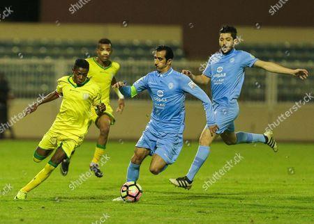 Najran player Hamad Al-Rabaei (L) in action for the ball with Al-Batin player Abdullah Al-Jaoaei (R) during the Saudi Professional League play off  soccer match between Najran and Al-Batin at Prince Sultan Bin Abdulaziz Stadium, Mahalah, Saudi Arabia, 11 May 2017.