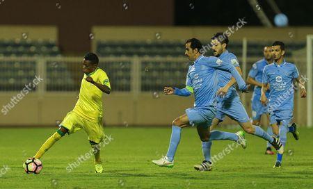 Stock Picture of Najran player Hamad Al-Rabaei (L) in action for the ball with Al-Batin player Abdullah Al-Jaoaei (R) during the Saudi Professional League play off  soccer match between Najran and Al-Batin at Prince Sultan Bin Abdulaziz Stadium, Mahalah, Saudi Arabia, 11 May 2017.