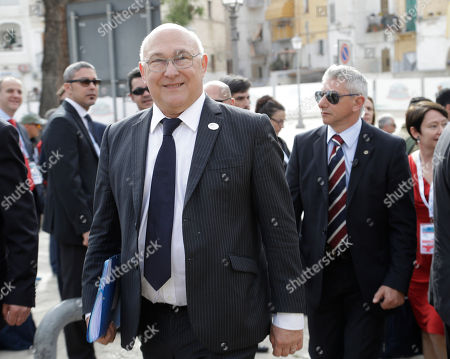 French Finance Minister Michel Sapin arrives for the opening session of the G7 of Finance ministers in Bari, southern Italy