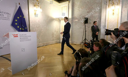 Austrian Foreign Minister Sebastian Kurz arrives for a news conference at the foreign ministry in Vienna, Austria, . Kurz, an influential figure in the country's junior governing People's party, OEVP, is calling for early elections in Austria after Vice Chancellor Reinhold Mitterlehner resigned earlier this week