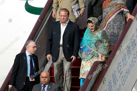 Nawaz Sharif, Kalsoom Nawaz Sharif Pakistani Prime Minister Nawaz Sharif, center, and his wife Kalsoom Nawaz Sharif arrive on a flight at Beijing's International Airport ahead of the Belt and Road Forum in Beijing