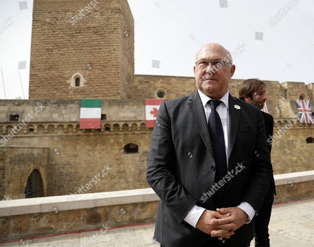 French Finance Minister Michel Sapin poses for photographers in front of the Castle of Bari, venue of the G7 of Ministers of finance, in Bari, southern Italy