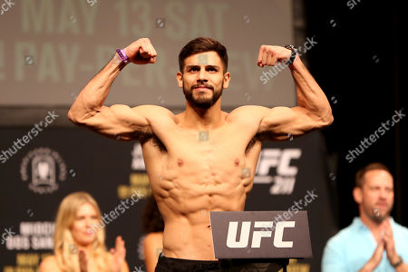 Yair Rodriguez poses for photographers during a weigh-in before UFC 211, in Dallas before UFC 211
