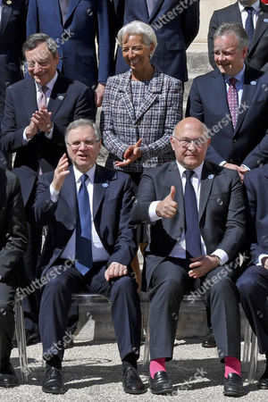 (L-R, top)  President of the European Central Bank (ECB), Mario Draghi, Managing Director of the International Monetary Fund (IMF), Christine Lagarde, Bank of Canada Governor, Stephen Shawn Poloz, (L-R, bottom) Bank of Italy Governor Ignazio Visco, and French Minister for Economy and Finance, Michel Sapin, during a group photo at the G7 Ministerial Meeting of Finance in Bari, Italy, 13 May 2017. The G7 Finance Ministers and Central Bank Governors meeting takes place in Bari from 11 to 13 May 2017.