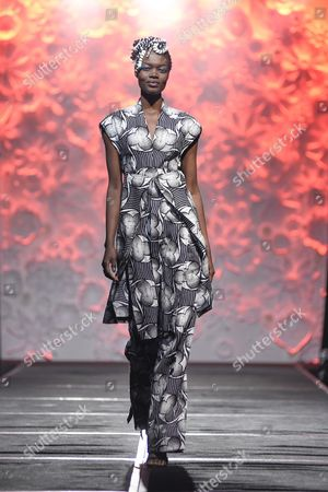 Model on the catwalk showcasing a design on African fabric