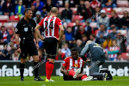 Sunderland forward Victor Anichebe (28) gets injured during the Premier League match between Sunderland and Swansea City at the Stadium Of Light, Sunderland