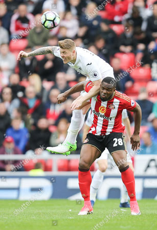 Alfie Mawson of Swansea City gets above Victor Anichebe of Sunderland to win the ball