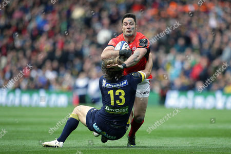 Stock Picture of Brad Barritt of Saracens is tackled by Aurelien Rougerie of Clermont Auvergne