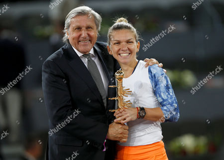 Simona Halep of Romania celebrates becoming Champion with the trophy and Ilie Nastase at the Mutua Madrid Open, Madrid, Spain on Saturday, May 13th, 2017