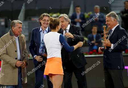 Simona Halep of Romania celebrates becoming Champion with Ilie Nastase at the Mutua Madrid Open, Madrid, Spain on Saturday, May 13th, 2017