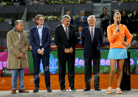 Ilie Nastase looks at Kristina Mladenovic of France during the presentation at the Mutua Madrid Open, Madrid, Spain on Saturday, May 13th, 2017