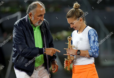 Simona Halep of Romania celebrates becoming Champion with the trophy and Ion Tiriac at the Mutua Madrid Open, Madrid, Spain on Saturday, May 13th, 2017
