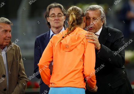 Ilie Nastase of Romania kisses Kristina Mladenovic at the Mutua Madrid Open, Madrid, Spain on Saturday, May 13th, 2017
