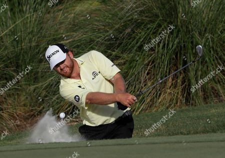 J.B. Holmes J. B. Holmes hits from the sand onto the 14th green during the third round of The Players Championship golf tournament, in Ponte Vedra Beach, Fla