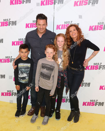 Bart Johnson (C) and Robyn Lively (R) with kids
