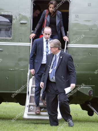 Deputy National Security Advisor for Strategy Dina Powell, top, Senior Advisor Stephen Miller, center, and Chief Strategist Steve Bannon, bottom, disembark from Marine One on the South Lawn of the White House in Washington, DC after traveling with United States President Donald Trump to Lynchburg, Virginia where the President made remarks at the Liberty University Commencement ceremony.