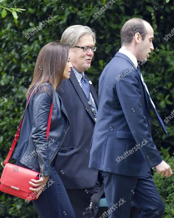 Deputy National Security Advisor for Strategy Dina Powell, left, Chief Strategist Steve Bannon, center, and Senior Advisor Stephen Miller, right, walk to the West Wing after disembarking from Marine One on the South Lawn of the White House in Washington, DC after traveling with United States President Donald J. Trump to Lynchburg, Virginia where the President made remarks at the Liberty University Commencement ceremony.