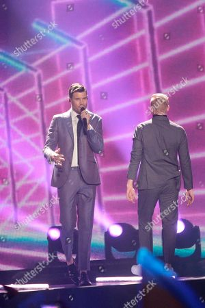 """Robin Bengtsson, left, from Sweden performs the song """"I Can't Go On"""" during the Final for the Eurovision Song Contest, in Kiev, Ukraine"""