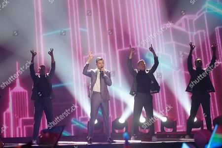 """Robin Bengtsson, second left, from Sweden performs the song """"I Can't Go On"""" during the Final for the Eurovision Song Contest, in Kiev, Ukraine"""