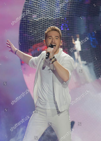 """Stock Photo of Nathan Trent from Austria performs the song """"Running on Air"""" during the Final for the Eurovision Song Contest, in Kiev, Ukraine"""