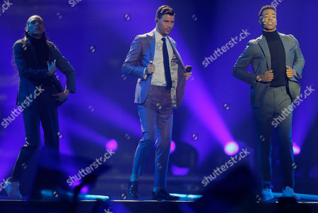 """Robin Bengtsson from Sweden, center, performs the song """"I Can't Go On""""during the Final for the Eurovision Song Contest, in Kiev, Ukraine"""