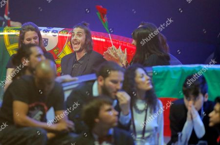 Salvador Sobral from Portugal, top center, and Kristian Kostov from Bulgaria, bottom right, react during the voting stage of the Final for the Eurovision Song Contest, in Kiev, Ukraine